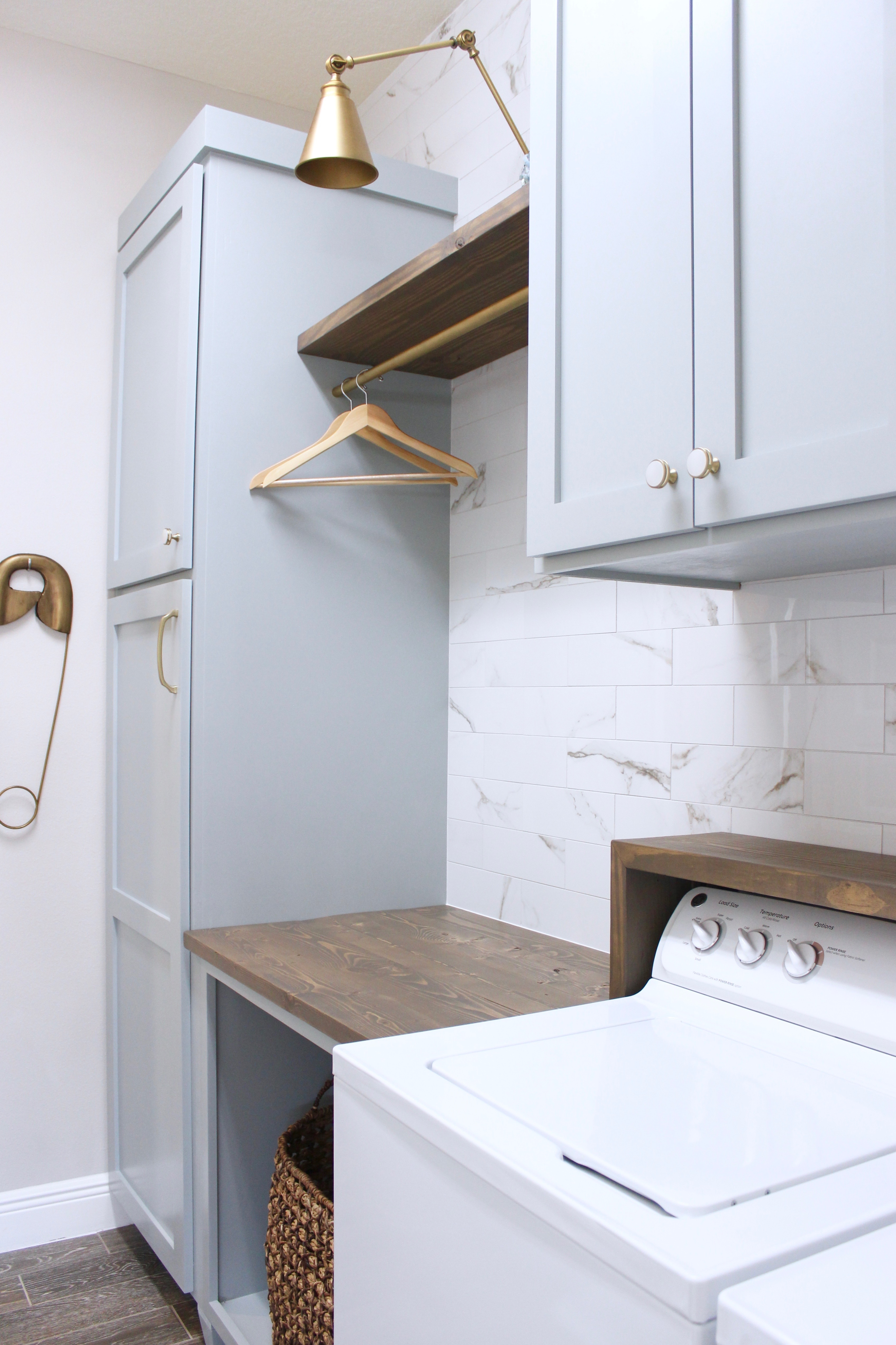 Laundry Room Diy Cabinets Painted Blue Marble Wall Tile Gold Sconce Light Frills And Drills